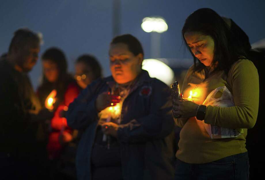 Ericka Rivera, right, attends a prayer vigil in the parking lot of the Bill Neal Center next to Channelview High School, Tuesday, March 13, 2018. The crash of a charter bus carrying a high school band from Florida to Texas left a driver dead and about three dozen people injured in south Alabama. The cause of the crash wasn't immediately known, but survivors from Channelview High School in metro Houston described being asleep one moment and tumbling through the air the next. Photo: Mark Mulligan / Mark Mulligan / Associated Press / © 2018 Houston Chronicle