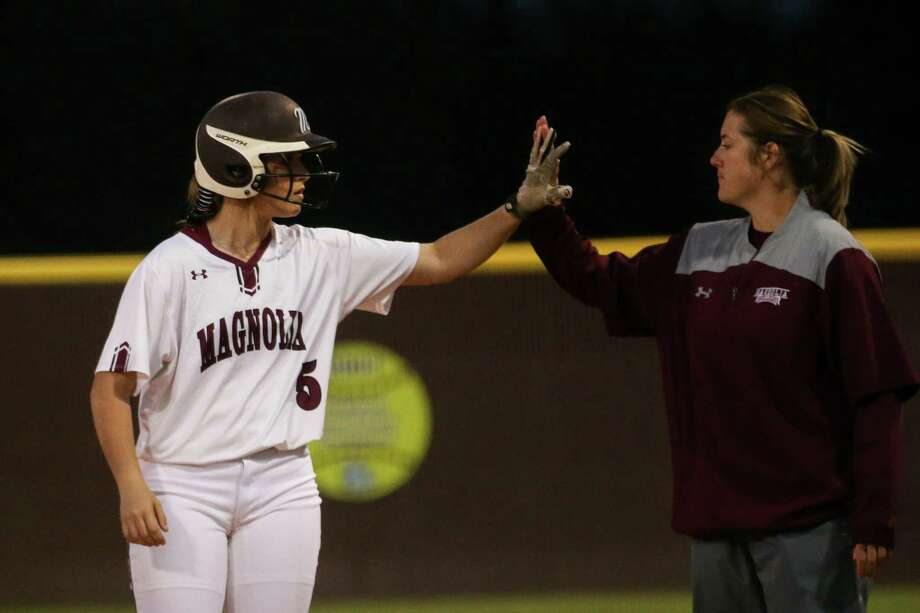 Magnolia's Julia Herzinger (5) celebrates after hitting a single during the softball game against Magnolia West on Tuesday, March 13, 2018, at Magnolia High School. (Michael Minasi / Houston Chronicle) Photo: Michael Minasi, Staff Photographer / © 2018 Houston Chronicle
