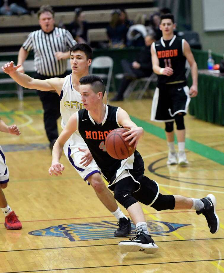 Mohonasen's  Duncan Tallman (4) moves the ball against Amsterdam during the second half of a Section II Class A boys' basketball quarterfinal game on Sunday, Feb. 26, 2017, in Troy, N.Y. (Hans Pennink / Special to the Times Union) ORG XMIT: HP102 Photo: Hans Pennink / Hans Pennink
