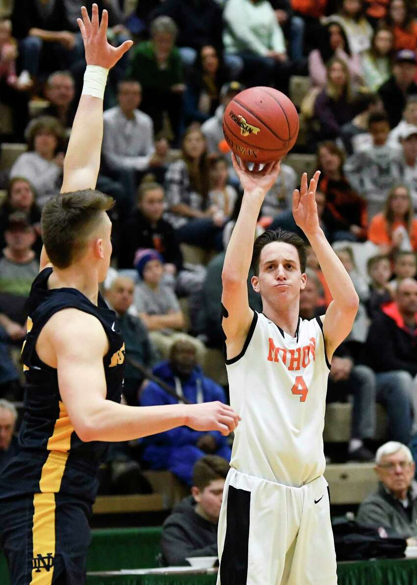 Mohonasen's Duncan Tallman (4) puts up a shot against Utica Notre Dame during a Class A boys' high school basketball state quarterfinal game Saturday, March 10, 2018, in Troy, N.Y. (Hans Pennink / Special to the Times Union)
