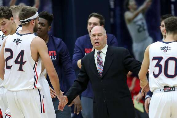 Saint Mary's head coach Randy Bennett greets Calvin Hermann (24) after a time out in 2nd quarter against Southeastern Louisiana during NIT first round game in Moraga, Calif., on Tuesday, March 13, 2018.