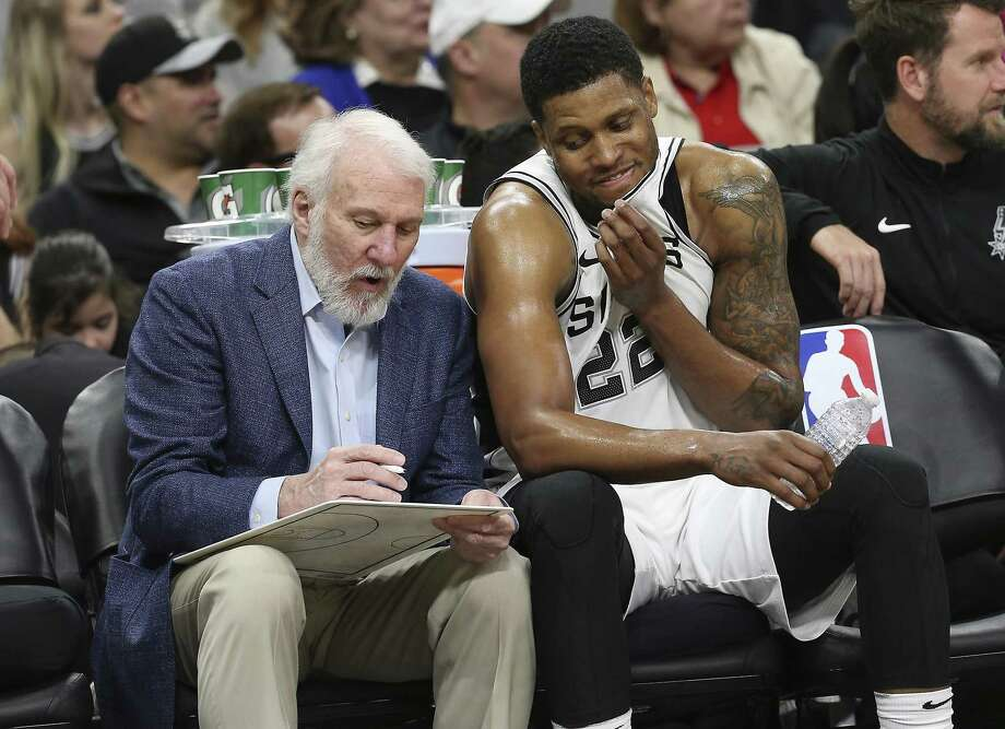 Spurs head coach Gregg Popovich talks with Rudy Gay (22) on the bench during the game against the Orlando Magic at the AT&T Center on Tuesday, Mar. 13, 2018. Spurs defeated the Magic, 108-72. (Kin Man Hui/San Antonio Express-News) Photo: Kin Man Hui, Staff / San Antonio Express-News / ©2018 San Antonio Express-News