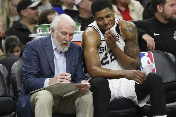 Spurs head coach Gregg Popovich talks with Rudy Gay (22) on the bench during the game against the Orlando Magic at the AT&T Center on Tuesday, Mar. 13, 2018. Spurs defeated the Magic, 108-72. (Kin Man Hui/San Antonio Express-News)