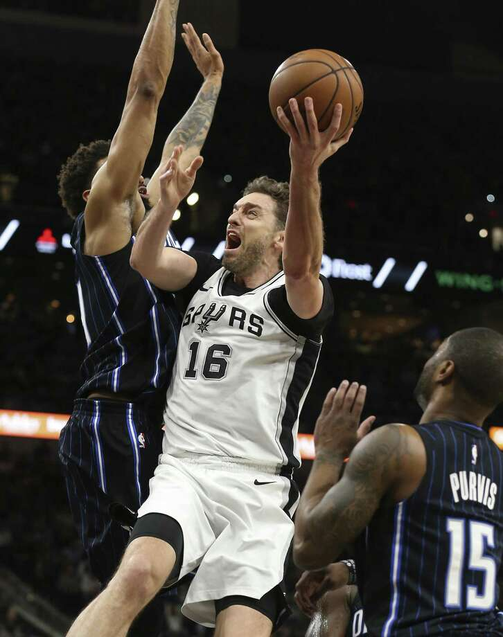Spurs' Pau Gasol (16) gets fouled as the attempts a shot by Orlando Magic's Khem Birch (24) and Rodney Purvis (15) during their game at the AT&T Center on Tuesday, Mar. 13, 2018. (Kin Man Hui/San Antonio Express-News) Photo: Kin Man Hui, Staff / San Antonio Express-News / ©2018 San Antonio Express-News