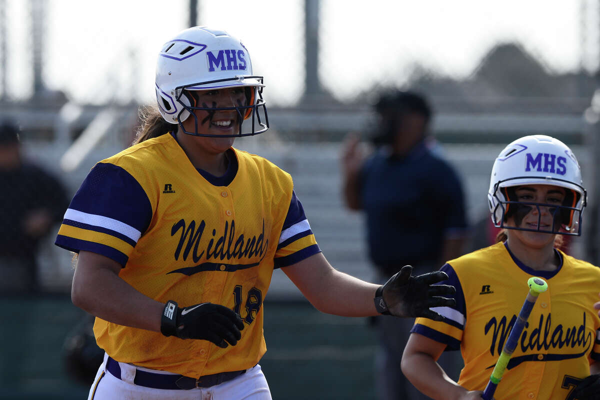 Midland High's Deanna Machuca high fives teammates during the game against Amarillo Tascosa March 13, 2018, at Audrey Gill Sports Complex. James Durbin/Reporter-Telegram