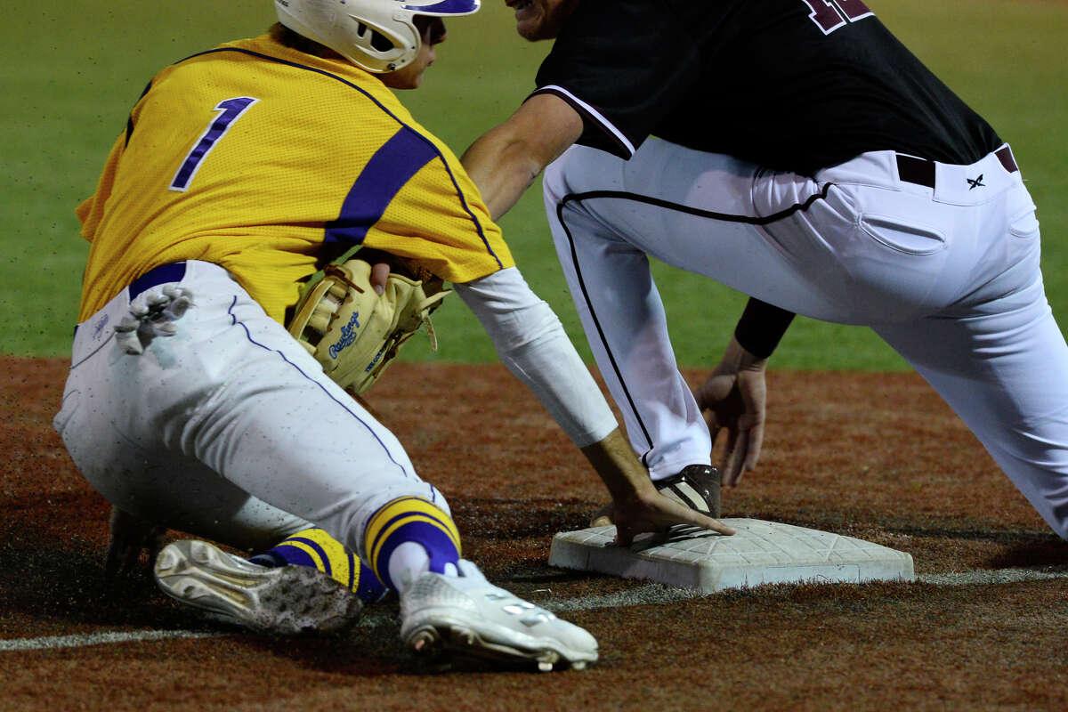 Midland High's Cooper Juaz (1) makes it to third base safely against Lee's Adam Becker (12) March 13, 2018, at Christensen Stadium. James Durbin/Reporter-Telegram