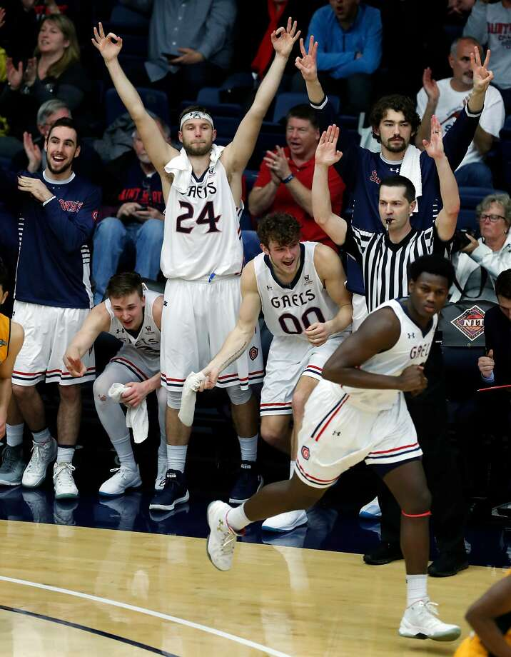 Saint Mary's Calvin Hermann (24) celebrates a 3-pointer by Elijah Thomas in 4th quarter against Southeastern Louisiana during NIT first round game in Moraga, Calif., on Tuesday, March 13, 2018. Photo: Scott Strazzante, The Chronicle