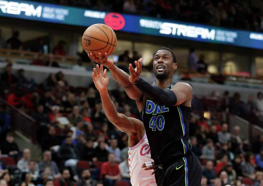 Dallas Mavericks' Harrison Barnes (40) scores past Chicago Bulls' Kris Dunn during the first half of an NBA basketball game Friday, March 2, 2018, in Chicago. (AP Photo/Charles Rex Arbogast) Photo: Charles Rex Arbogast / Copyright 2018 The Associated Press. All rights reserved.