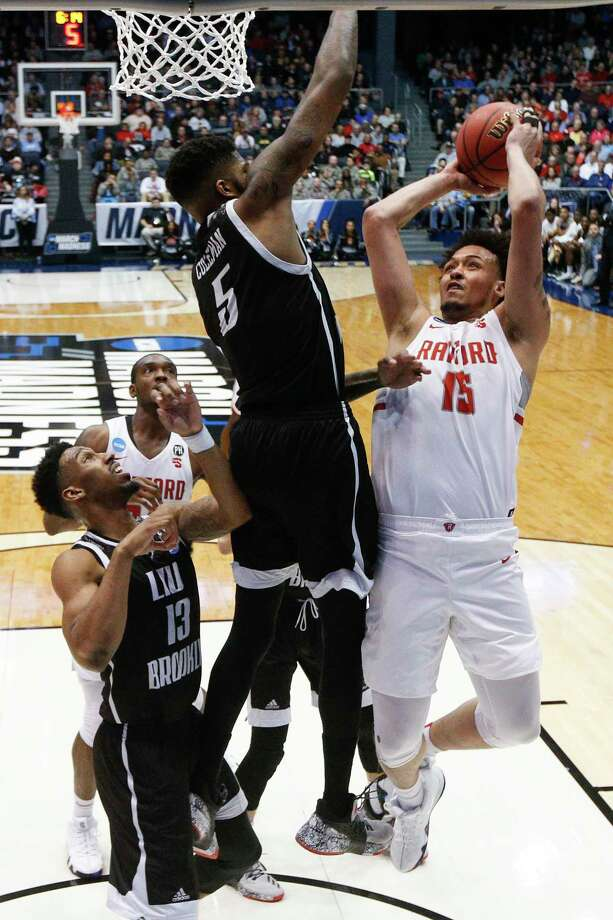 Radford's Devonnte Holland (15) shoots against LIU Brooklyn's Zach Coleman (5) during the second half of a First Four game of the NCAA men's college basketball tournament, Tuesday, March 13, 2018, in Dayton, Ohio. Radford won 71-61. (AP Photo/John Minchillo) Photo: John Minchillo / AP