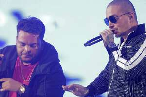 J Balvin, right,  performs with Jeon during the 2018 Houston Livestock Show and Rodeo at NRG Stadium on  Tuesday, March 13, 2018, in Houston.