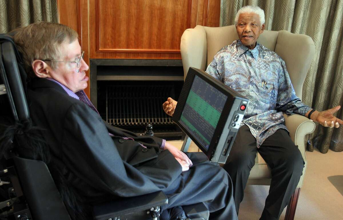 (FILES) In this file photo taken on May 14, 2008, South Africa former President Nelson Mandela (R) meets with British scientist Professor Stephen Hawking (L) in Johannesburg. Renowned British physicist Stephen Hawking has died at age 76, a family spokesman said Wednesday, March 14, 2018. We are deeply saddened that our beloved father passed away today,