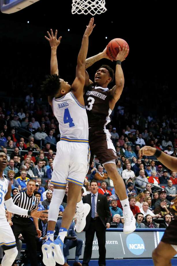 DAYTON, OH - MARCH 13: Jaylen Adams #3 of the St. Bonaventure Bonnies drives to the basket against Jaylen Hands #4 of the UCLA Bruins during the first half of the First Four game in the 2018 NCAA Men's Basketball Tournament at UD Arena on March 13, 2018 in Dayton, Ohio.  (Photo by Kirk Irwin/Getty Images) Photo: Kirk Irwin / 2018 Getty Images