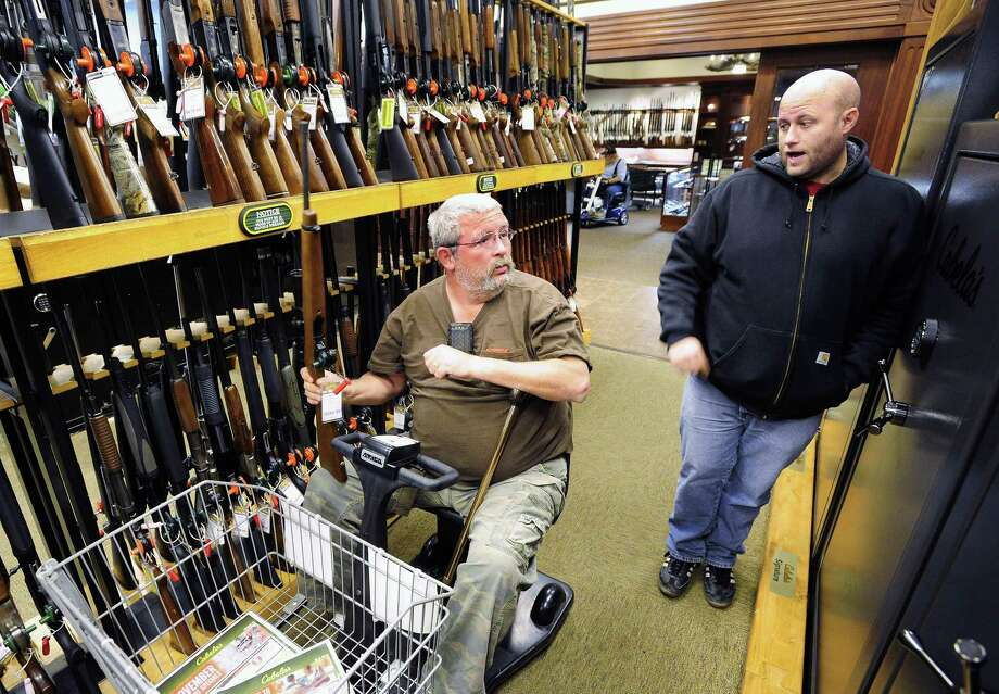 Jerry Lyons, left, talks with Pat Ison at the Cabela's store in Dundee, Mich. Photo: Daniel Mears / Daniel Mears / Detroit News / Detroit News
