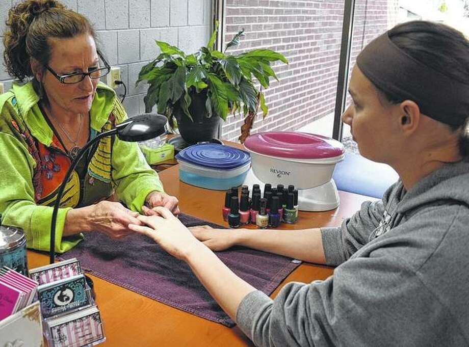 Kiersten Hann of Moline, a junior at MacMurray College, gets a manicure Tuesday from Tonda Rolson of A Touch of Class Salon and Spa during MacMurray's Spa Week on campus. Photo: Audrey Clayton   Journal-Courier