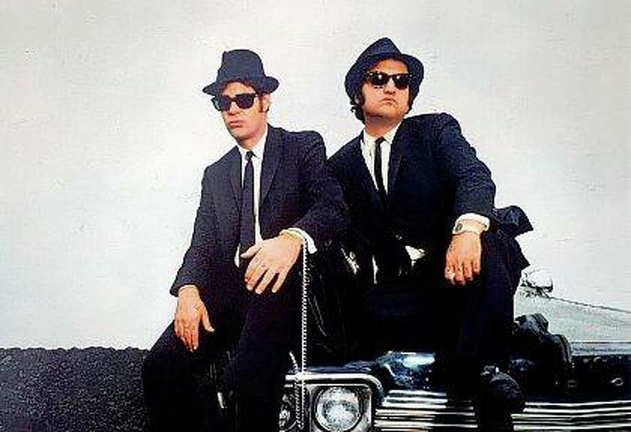 "Jake (John Belushi) is released from prison and reunites with his brother, Elwood (Dan Aykroyd), in ""Blues Brothers."" The mission is to raise the money needed to keep an orphanage from closing."