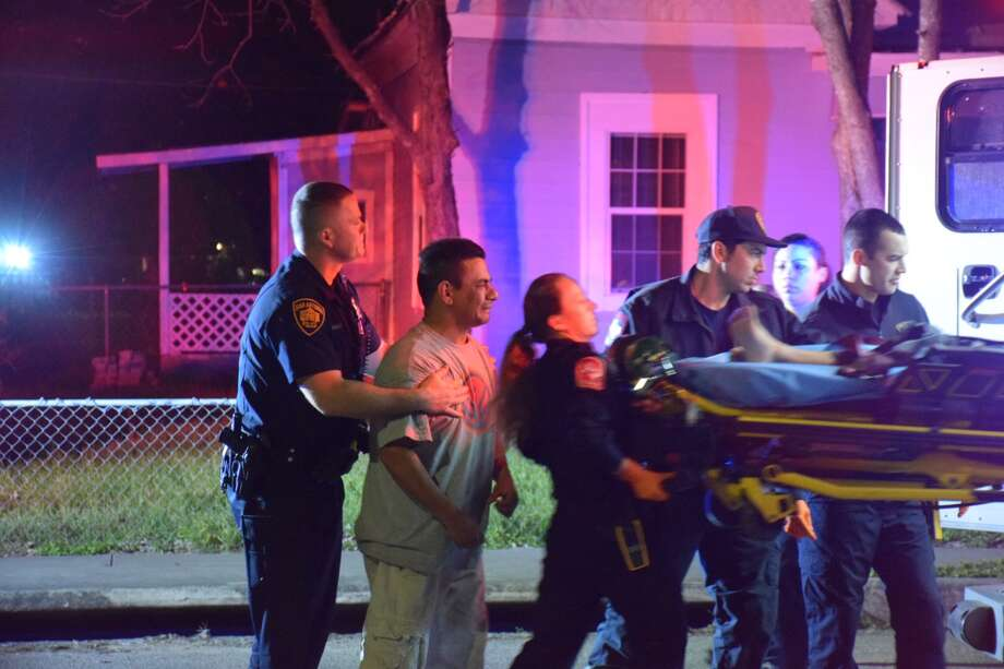 A young boy was hospitalized in an apparent shooting on Wednesday, March 14, 2018 around 6:15 a.m. to the 100 block of Denver Boulevard. The boy's relatives screamed in grief as he was carted by paramedics. Photo: Caleb Downs / San Antonio Express-News