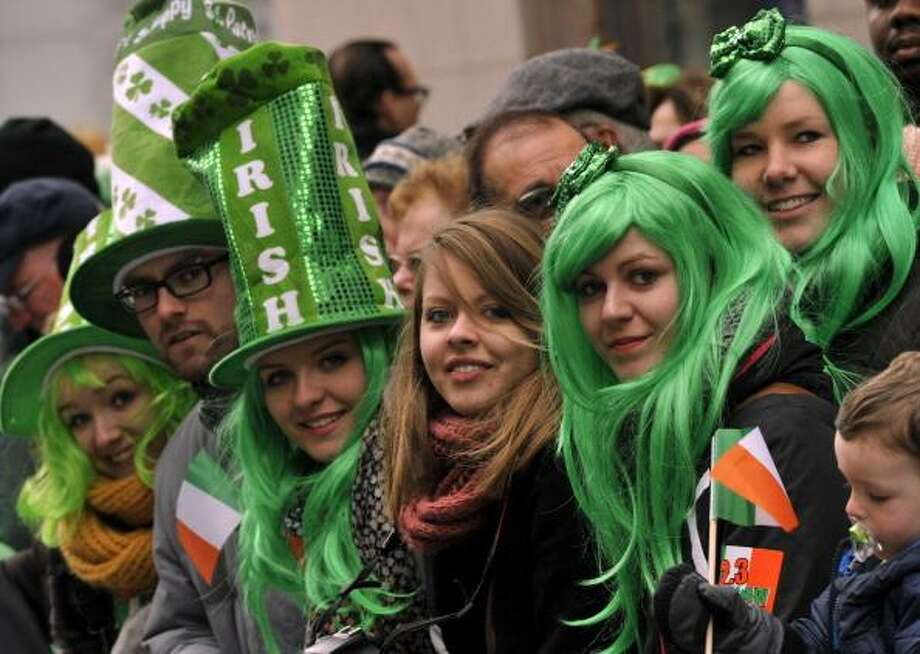 Parade-goers watch as matching bands make their way  up 5th Avenue during the 252th New York City St. Patrick's Day Parade on March 16, 2013.    AFP PHOTO/TIMOTHY A. CLARY        (Photo credit should read TIMOTHY A. CLARY/AFP/Getty Images) Photo: TIMOTHY A. CLARY / AFP/Getty Images / Getty Images