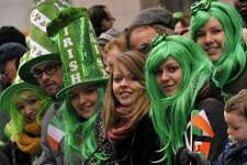 Parade-goers watch as matching bands make their way  up 5th Avenue during the 252th New York City St. Patrick's Day Parade on March 16, 2013.    AFP PHOTO/TIMOTHY A. CLARY        (Photo credit should read TIMOTHY A. CLARY/AFP/Getty Images)