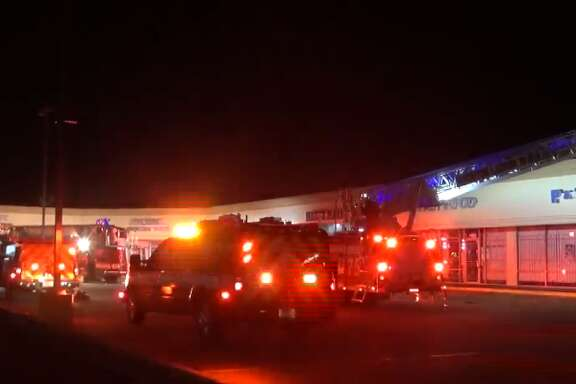 Houston firefighters extinguished an early morning fire at Reina's Restaurant Pupeseria in west Houston, Wednesday, March 14, 2018.