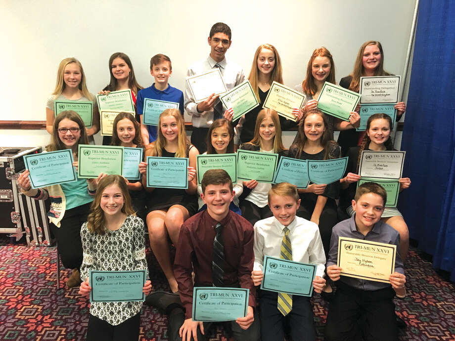 St. Boniface students with their awards after the Model UN. From  left, first row: Maya Lueking, Ryan Luitjohan, Jacob Huber, Joey Hyten. Middle Row: Katie Greer, Claire Stanhaus, Maggie Pifer, Kaitlyn Hatley, Makenna Lueking, Grace Stanhaus, and Caroline Marcus. Back row: Ella Heddinghaus, Maddie Burkart, Justin Jones, Maddie Burkart, Grace Stanhaus, Ryan Luitjohan  Back row: Ellie Hyten,  Hersch Greene and Reese Pifer. Photo: Carol Arnett • Carnett.edwi@gmail.com
