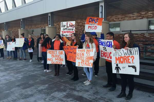 Danbury High School students walked out of class Wednesday, March 14, to show solidarity with victims of the school shooting in Parkland, Florida.