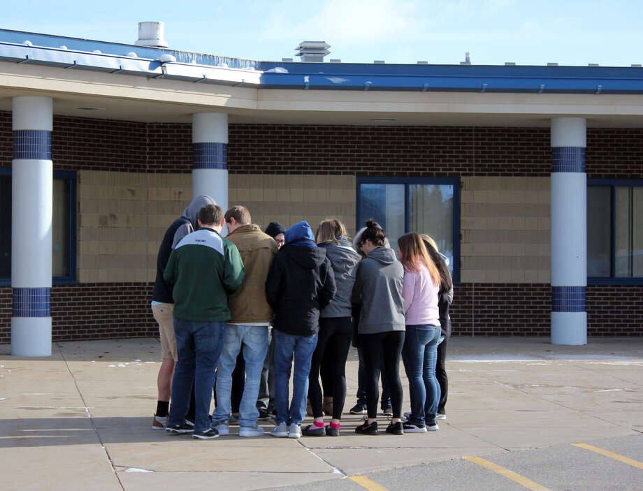 Fourteen Bad Axe High School seniors participated in National Walkout Day Wednesday morning at 10 a.m. Students said they walked out to honor innocent people who had been killed. The school had observed a 17-second moment of silence at 9:59 for victims of the Marjory Stoneman Douglas High School shooting last month in Parkland, Florida, according to Bad Axe High School Principal Kurt Dennis. Photo: Brenda Battel/Huron Daily Tribune
