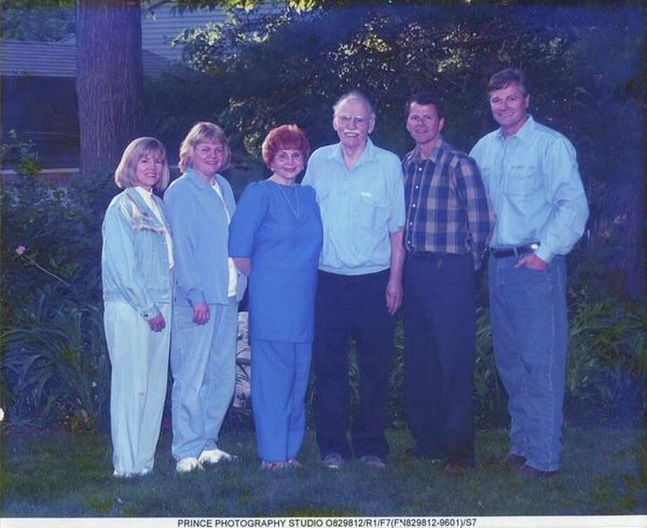 Barb and Lovell Sovereen pose proudly with their four children in the garden at their home. From left are Deanne, Deborah, Barb, Lovell, Mark and Scott.