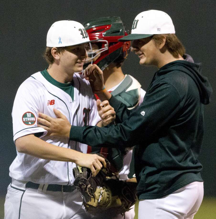 The Woodlands starting pitcher Steven Beard (16) is greated by teammates  after the final out of the seventh inning as the Highlanders defeated Montgomery 3-1 in the first District 12-6A game of the season, Tuesday, March 13, 2018, in The Woodlands. Photo: Jason Fochtman/Houston Chronicle