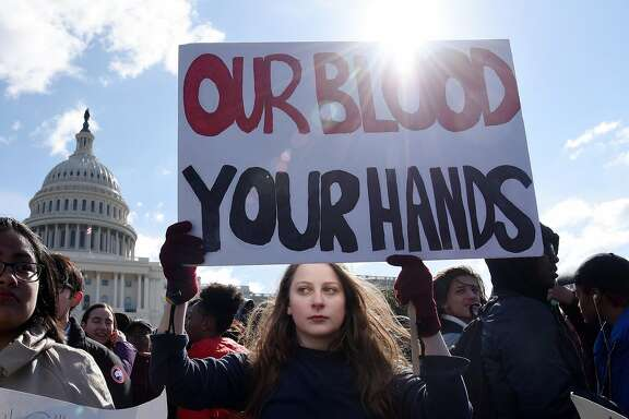 Students gather at the U.S. Capitol to protest gun violence Wednesday, March 14, 2018 in Washington, D.C. (Olivier Douliery/Abaca Press/TNS)