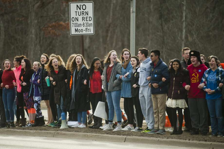 Students participate in a school walk out in protest of gun violence on Wednesday, March 14, 2018 at Dow High School. Protests were organized by high school students across the country on Wednesday, one month after 17 people were killed in a shooting at a high school in Parkland, Florida. (Katy Kildee/kkildee@mdn.net) Photo: (Katy Kildee/kkildee@mdn.net)