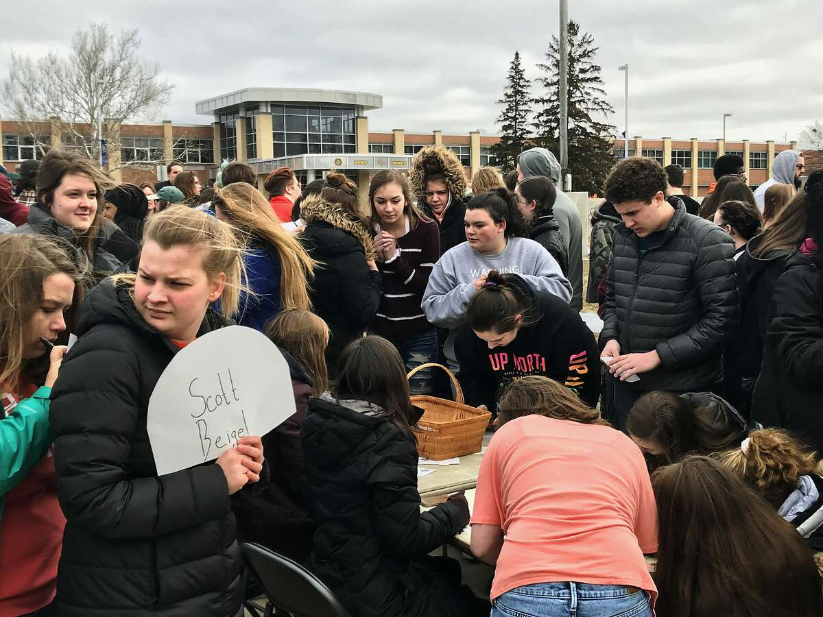 Students participate in a school walk out in protest of gun violence on Wednesday, March 14, 2018 at Midland High School. Protests were organized by high school students across the country on Wednesday, one month after 17 people were killed in a shooting at a high school in Parkland, Florida. (Kate Carlson/kcarlson@mdn.net)