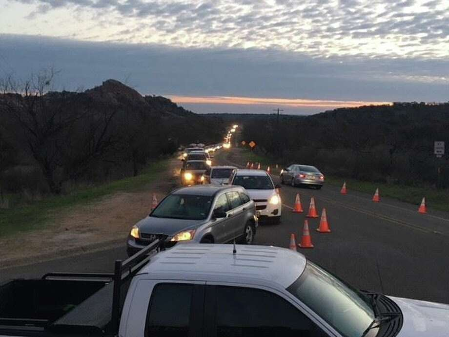 """Enchanted Rock State Natural Area: """"Good morning! We took this photo of our line for park entry this morning at 7:30am. If you are not in line already, you are unlikely to be able to enter today."""" Photo: Facebook/Enchanted Rock State Natural Area"""