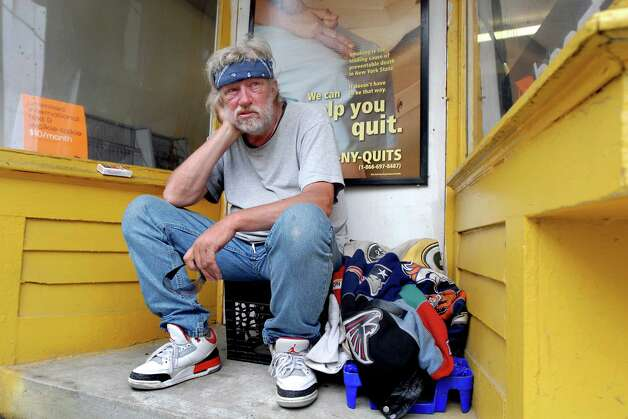 Poppy's friend Tom sits with his belongings in an alcove on Thursday, July 16, 2009, on Pearl Street in Albany, N.Y. (Cindy Schultz / Times Union) Photo: CINDY SCHULTZ