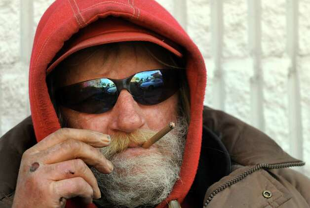 Poppy's friend Tom smokes a cigarillo as he rests in one of his favorite spots on Thursday, Oct. 22, 2009, on South Pearl Street in Albany, N.Y. (Cindy Schultz / Times Union) Photo: CINDY SCHULTZ