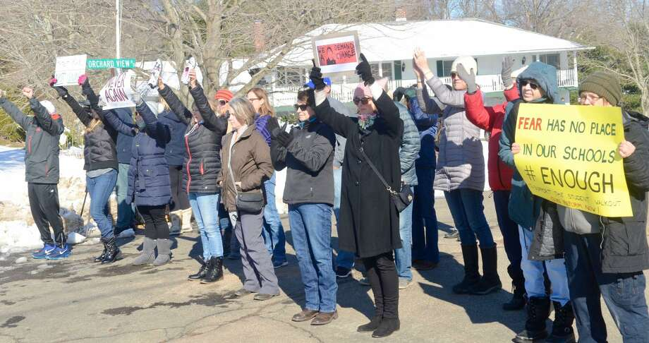 Students and adults at Guilford High School Wednesday participate in the national school walkout. Photo: Kelly Goddard