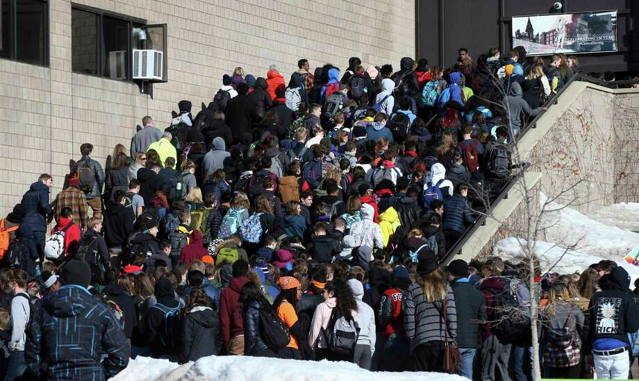 Students file back into their high school after they participated in the national gun violence walkout in St. Paul, Minn. Photo: Jim Mone, Associated Press / Copyright 2018 The Associated Press. All rights reserved.