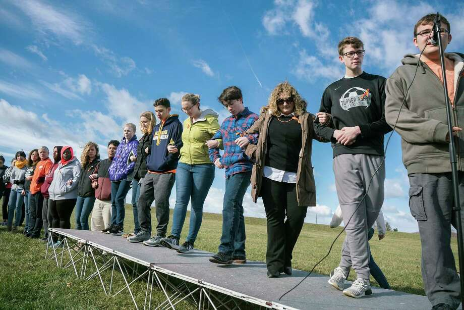 High school students in Bridgewater, Va., read the names of the victims of the shooting in Parkland during the National School Walkout on March 14, 2018. Photo: Nikki Fox, Associated Press / Daily News-Record