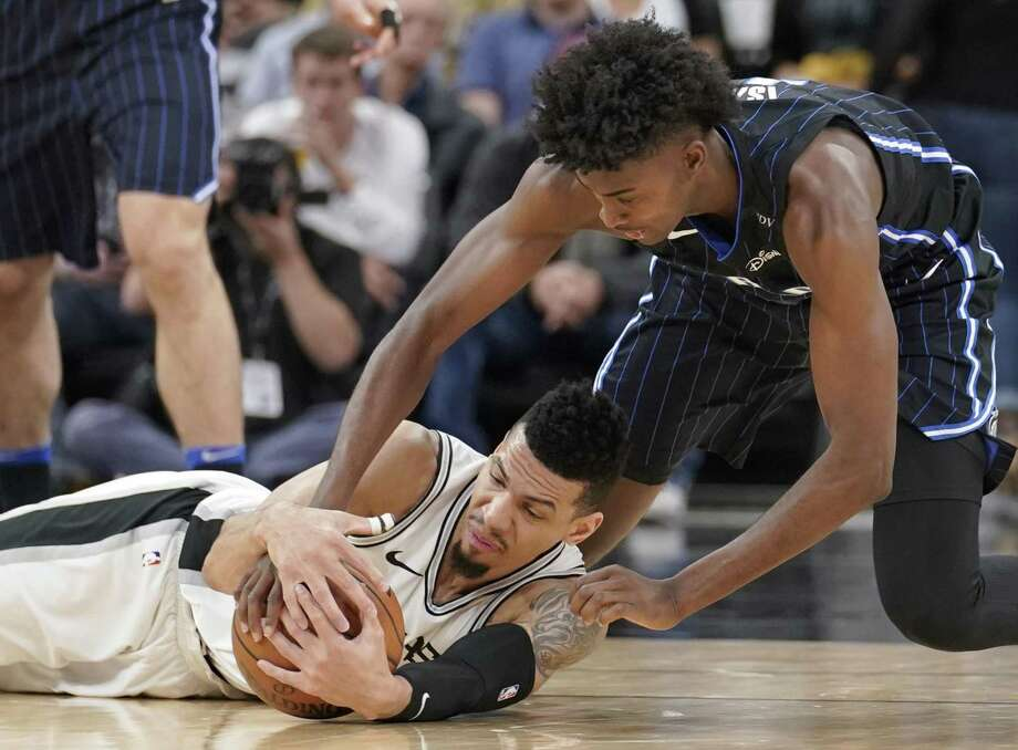 San Antonio Spurs' Danny Green, left, and Orlando Magic's Jonathan Isaac chase the ball during the first half of an NBA basketball game, Tuesday, March 13, 2018, in San Antonio. (AP Photo/Darren Abate) Photo: Darren Abate, FRE / Associated Press / FR115 AP