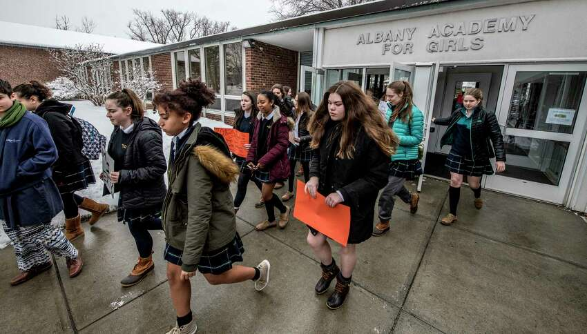 Students at the Albany Academy for Girls walkout of class for 17 minutes in support of victims of the shooting at Marjory Stoneman Douglas High School in Florida Wednesday March 14, 2018 Albany, N.Y. (Skip Dickstein/Times Union)