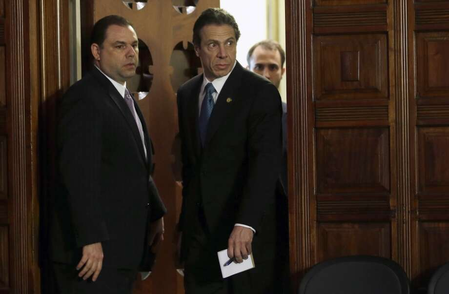 Joseph Percoco, executive deputy secretary, left, and Gov. Andrew Cuomo, right, enter the Red Room Friday, April 26, 2013, during a press conference at the Capitol in Albany, N.Y. (AP Photo/Mike Groll)