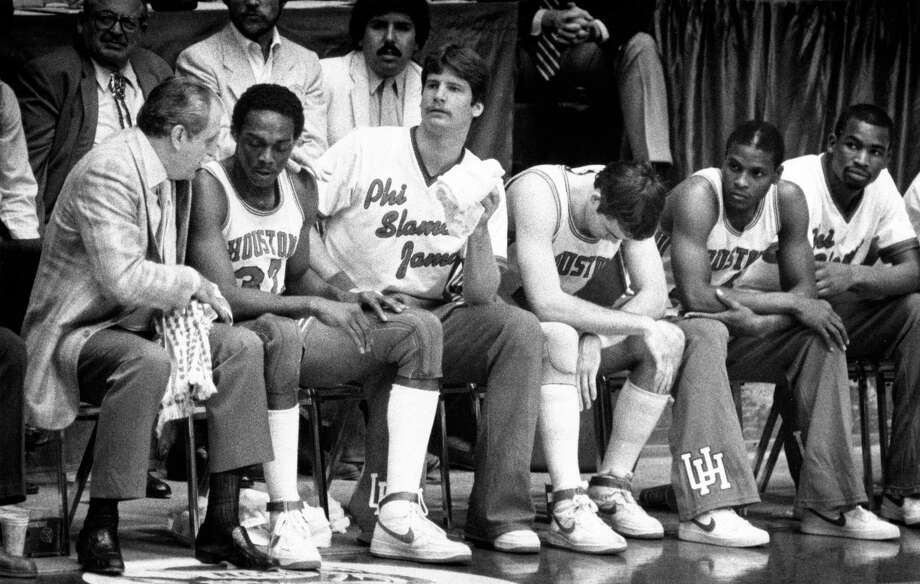 04/04/1983 - Houston Cougars coach Guy Lewis consoles Benny Anders (32) on the bench during the NCAA Final Four championship game against North Carolina State at The Pit in Albuquerque, New Mexico. Photo: Fred Bunch, Houston Chronicle / Houston Chronicle
