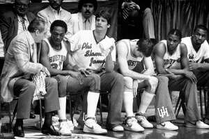 04/04/1983 - Houston Cougars coach Guy Lewis consoles Benny Anders (32) on the bench during the NCAA Final Four championship game against North Carolina State at The Pit in Albuquerque, New Mexico.