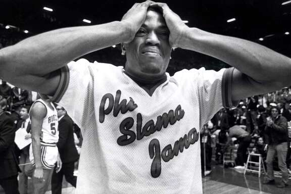 04/04/1983 - Cougar Renaldo Thomas holds his head after UH loses to NC State in the final of the NCAA basketball playoffs in Albuquerque, NM.
