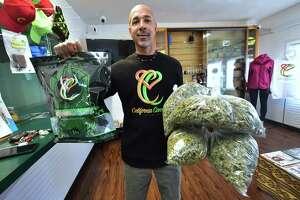 Cannabis entrepreneur Virgil Grant carries bags of medical marijuana at a dispensary he runs in Los Angeles.