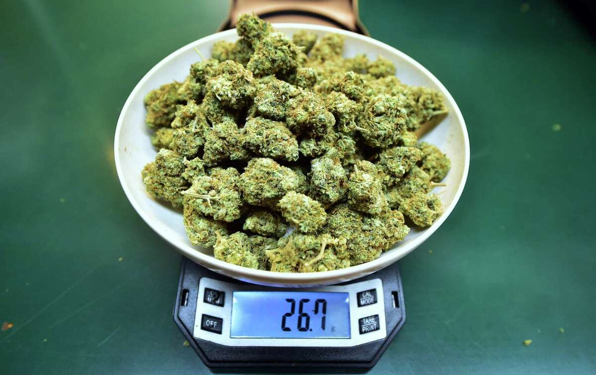 Marijuana on a scale at Virgil Grant's dispensary in Los Angeles. The amount shown is just under one ounce; possession of under a half-ounce is not a crime in Connecticut but is subject to an infraction with fines ranging from $150 to $500.