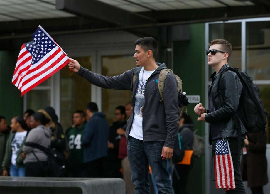 Daniel Reales (left) and Diego Anderson attend a rally while students at El Cerrito High School walk out of their classrooms in El Cerrito, Calif. on Wednesday, March 14, 2018. Both high school juniors are not in favor of gun control but came to honor the victims who died in last month�s school shooting. The walkout was part of a nationwide response by students to protest against gun violence one month after the deadly school shooting in Parkland, Fla. Photo: Paul Chinn, The Chronicle