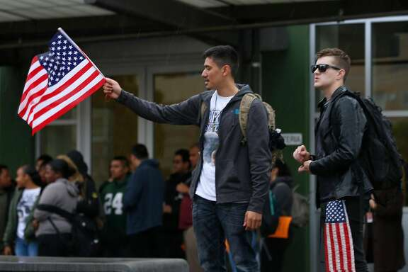 Daniel Reales (left) and Diego Anderson attend a rally while students at El Cerrito High School walk out of their classrooms in El Cerrito, Calif. on Wednesday, March 14, 2018. Both high school juniors are not in favor of gun control but came to honor the victims who died in last month�s school shooting. The walkout was part of a nationwide response by students to protest against gun violence one month after the deadly school shooting in Parkland, Fla.
