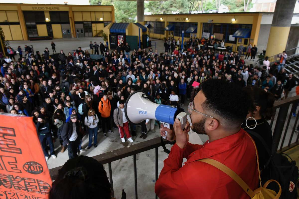 Academy of Arts and Sciences Senior Josiah Kelly speaks to a crowd students on Campus during a walkout in San Francisco to protest gun violence on Wed. March 14, 2018.