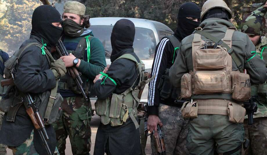 Al Qaeda-linked fighters from the Levant Liberation Committee prepare for battle in Idlib province, Syria. Photo: Associated Press