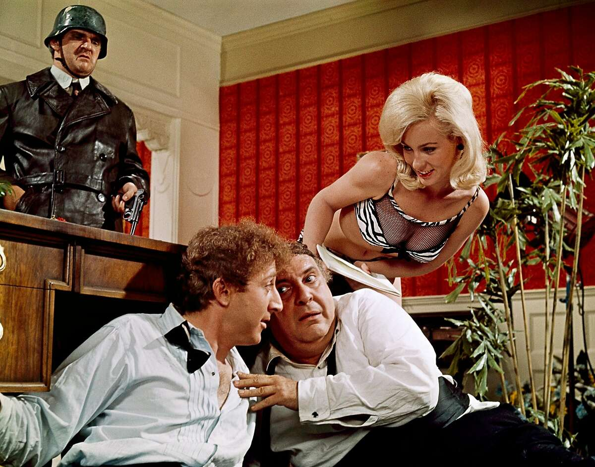 """In this 1968 film publicity image originally released by Embassy Pictures, from left, Kenneth Mars, Gene Wilder, Zero Mostel and Lee Meredith, are shown in a scene from the movie """"The Producers."""" Mars, a Mel Brooks collaborator who played a Hitler-worshipping playwright in """"The Producers"""" and an earnest police inspector with a malfunctioning artificial arm in """"Young Frankenstein,"""" died Saturday, Feb. 12, 2011, of pancreatic cancer at his home in Grenada Hills, Calif. He was 75. (AP Photo/Embassy Pictures)"""